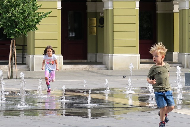 Running through the water spouts. Eger, Hungary.