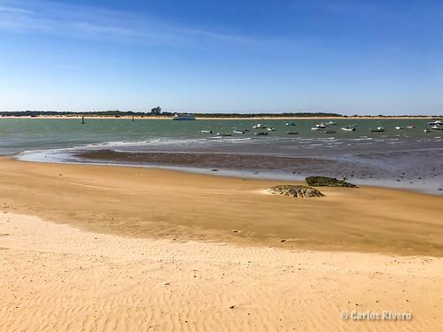 Desembocadura del Guadalquivir desde Bajo de Guía en Sanlucar, Cádiz. الوادي الكبير al-wādi al-kabīr, «el río grande»