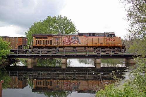 UP 5902, rear end distributed power on 813, is reflected in the waters of Duck Creek