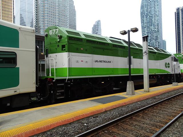 GO Transit 677 MPI MP54AC (MP40PH-T4AC) (2018) Is 2nd Unit MU To 678 Pushing An Westbound Mount Joy Train Departing Union Station Platform 24 With New Metrolinx Logo