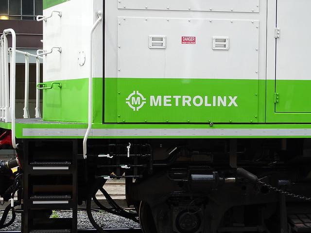 GO Transit 678 MPI MP54AC (MP40PH-T4AC) (2018), Locomotive Is MU With 677 Pushing An Westbound Mount Joy Train Departing Union Station Platform 24 With New Metrolinx Logo