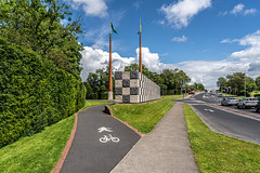 FLAGPOLES AND SCULPTURE AT THE ENTRANCE TO THE UNIVERSITY OF LIMERICK CAMPUS [ THE WALL OF LIGHT IS BY SEAN SCULLY]-153214
