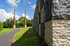 FLAGPOLES AND SCULPTURE AT THE ENTRANCE TO THE UNIVERSITY OF LIMERICK CAMPUS [ THE WALL OF LIGHT IS BY SEAN SCULLY]-153216