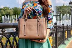 Woman holding fashion bag