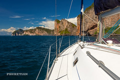 Sailing yacht near Phi Phi islands in our trip from Thailand to Malaysia. Islands, sails, blue water, and full relax        XOKA8428bs