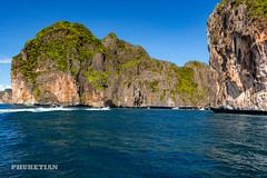 Sailing yacht near Phi Phi islands in our trip from Thailand to Malaysia. Islands, sails, blue water, and full relax        XOKA8400bs