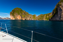 Sailing yacht near Phi Phi islands in our trip from Thailand to Malaysia. Islands, sails, blue water, and full relax        XOKA8404bs