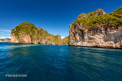 Sailing yacht near Phi Phi islands in our trip from Thailand to Malaysia. Islands, sails, blue water, and full relax        XOKA8401b2s