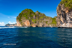 Sailing yacht near Phi Phi islands in our trip from Thailand to Malaysia. Islands, sails, blue water, and full relax        XOKA8399bs