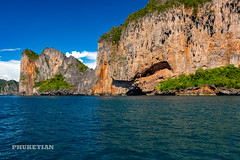 Sailing yacht near Phi Phi islands in our trip from Thailand to Malaysia. Islands, sails, blue water, and full relax        XOKA8432bs