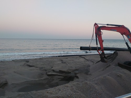 When in action they are dredging sand from seabed to spread on the beach