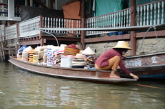 An isolated floating vendor of Thai hats
