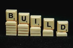 "Close up scrabble forming a ""build"" word"
