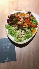 Veggie Bowl with grilled vegetables, Edamame, nuts, eggplants, basil, wholemeal rice & soy sesame sauce, next to a Fresh Menu Card