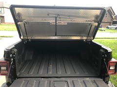 An Aluminum Truck Bed Cover On A Jeep Gladiator