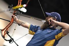 Navy veteran draws an arrow during the archery finals.