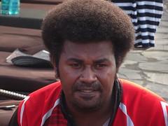 Fiji. Denarau Island. Pensive Fijian man at the Sofitel resort.