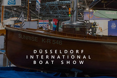 """Wooden steam boat Surnise K-R 546, exhibited at a fair in Germany, next to the title """"Düsseldorf International Boat Show"""""""