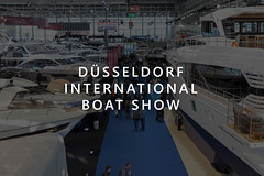 "Picture Title ""Düsseldorf International Boat Show"" with many luxury yachts and fair visitors at the German boat- and watersports fair"