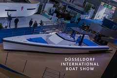 "Visitors at a water sports fair, next to picture title ""Düsseldorf International Boat Show"""