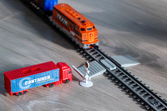 Railway crossing with a truck and a train at the barrier