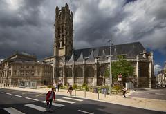 skating past a magnificent, if also one of the unluckiest, churches (L'église Saint-Laurent) in France, now a museum (Le Musée Le Secq des Tournelles). Rouen, Seine-Maritime, Normandie, France. Colour