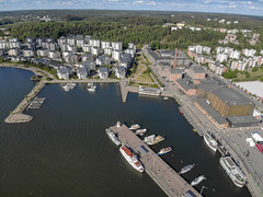 "Aerial photo shows a route section for the Finnish triathlon event ""Ironman 70.3"" at the coast of the port district of Lahti, with yachts and motor boats"