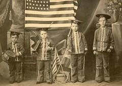 "Portrait of boys in ""Dewey"" costumes"