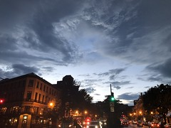 Evening sky clearing after heavy rain, Connecticut Avenue NW, Washington, D.C.