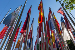 Various country flags on masts, in front of the European Patent Office in Munich, Germany