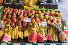 Close-up of colorful fruits like water melon, mango, bananas and pineapples, at a food market in Munich, Germany