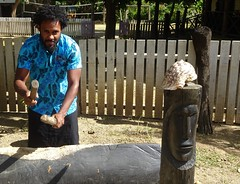 Nadi . Fiji. A Fijian guide welcomes people to the Fijian Cultural Centre in Nadi. Note shell and carved post.