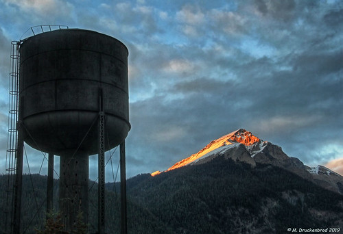 Field's Historic Water Tower with Sunset Colors skimming across a Mountain Peak