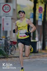 Sportler rennt den Köln Marathon