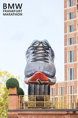 Gigantic Asics shoe statue during BMW Frankfurt Marathon in Germany