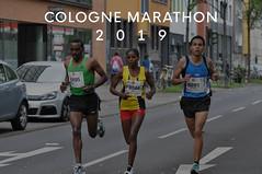Three marathon runners in a row during Cologne Marathon 2019