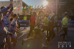 People at the Abott Dash to the Finish Line 5K - run, before New York City Marathon 2019 with sunshine in the backround
