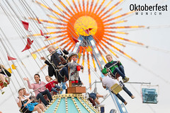 Kids and Parents in chairoplane carousel at Oktoberfest Munich in Bavaria