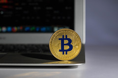 Golden Bitcoin on a laptop