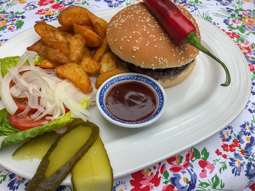 Wagyu Beef Burger with salad, cucumber, onion, tomato, chili pepper, french fries and barbecue sauce