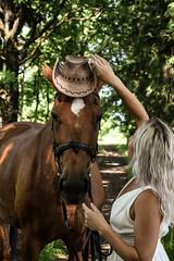 American-Beauty wearing cowboy hat