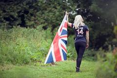 Team GB woman waving British union flag