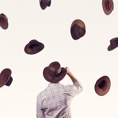 Cowboy Australian hats being thrown into the air