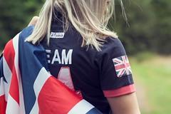Woman wearing British flag and team GB polo shirt
