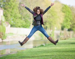 Woman doing star jump in full country attire