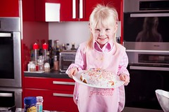 Little girl in kitchen baking cake on mothers day