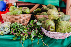 Green fruits and vegetables on baskets