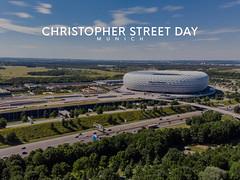 """Die Münchner Allianz-Arena als Hintergrundbild für den Titel """"Christopher Street Day Munich"""", um für LGBT-Rechte bei der CSD-Parade zu demonstrieren"""