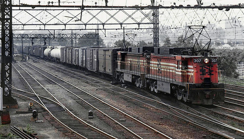 New Haven Railroad GE EF-4 motor # 307 & another leads an eastbound manifest freight train past the station at Stamford, Connecticut, ca 1968, Bob Hughes Photo