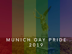 """The angel of peace """"Friedensengel"""" behind rainbow flags to celebrate Munich Gay Pride Parade 2019 during CSD"""